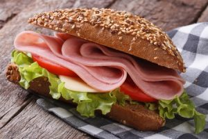 sandwich with ham, lettuce and tomatoes
